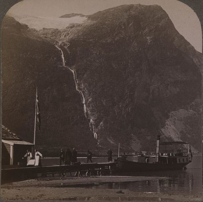"From the southern parts of the lake Lovatn, with the tourist boat ""Lodalen"" and the mountain Ramnefjellet in the background. Photo taken in the beginning of the 1900s."