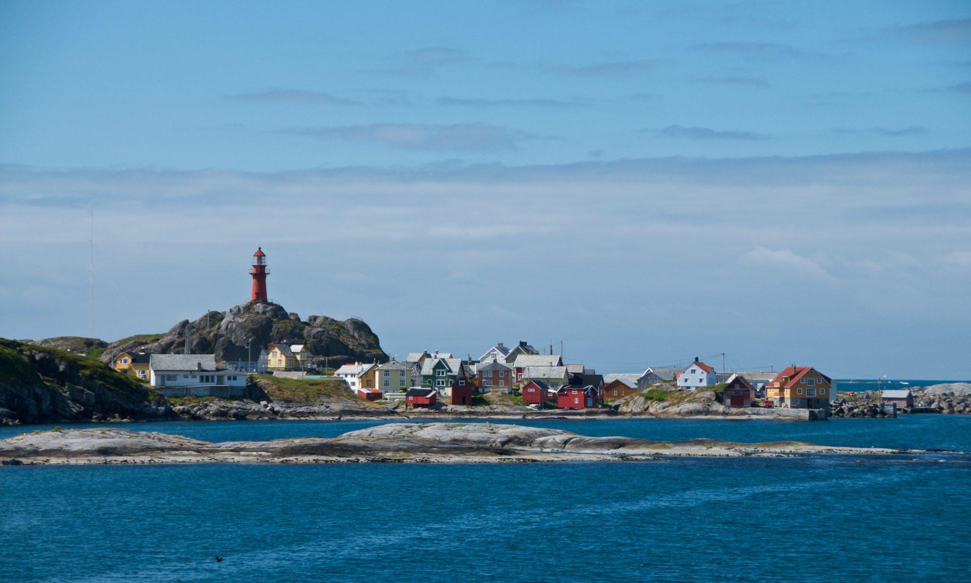 Ona Island and Ona Lighthouse on the Atlantic Coast outside Romsdal, Norway