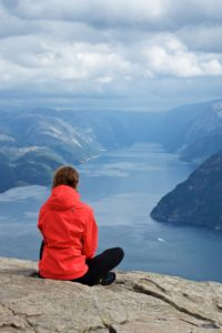 FJORDS NORWAY - Enjoying the view from Preikestolen towards the Lysefjord.