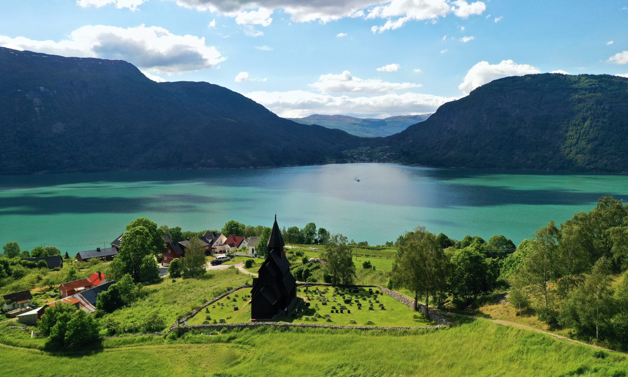 Fjords Norway - Urnes Stave Church by the Lustrafjord in Luster, Sognefjord in Norway