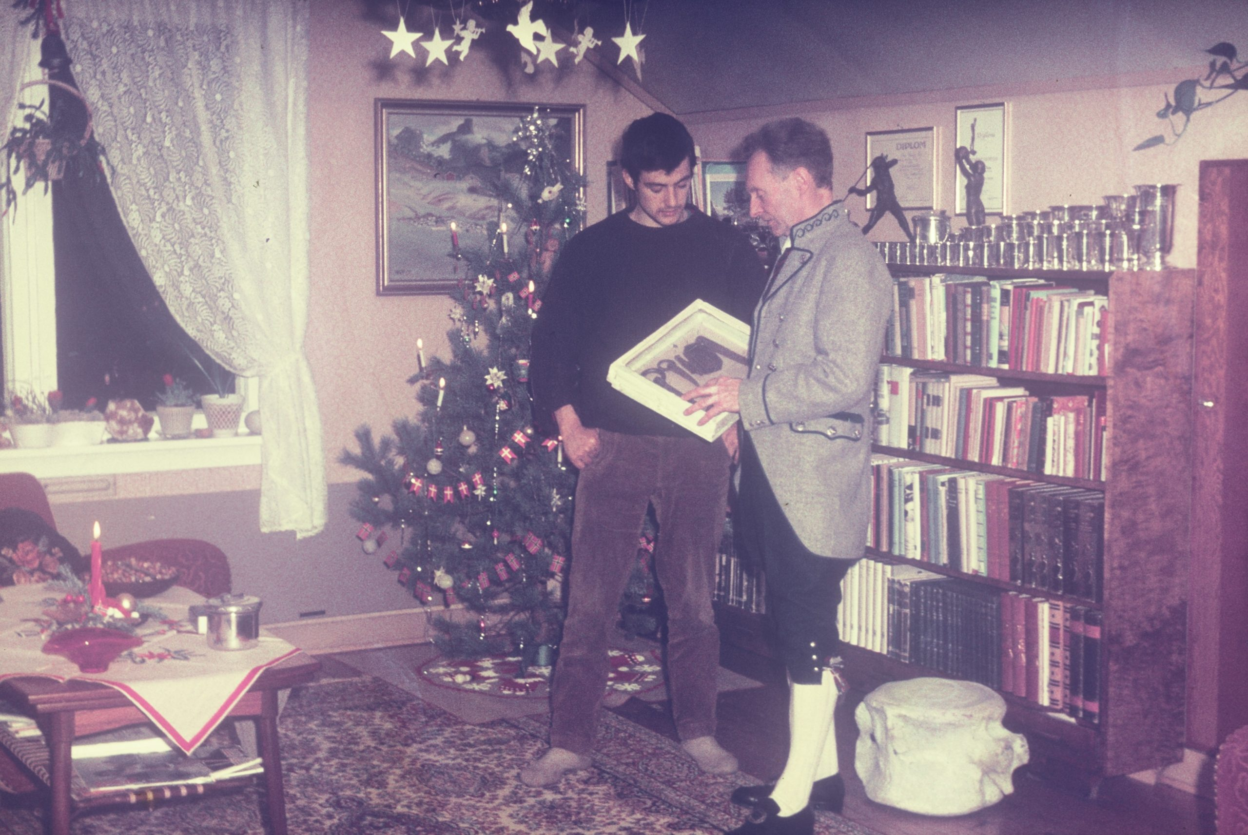 Tony Howard and Arne Randers Heen, New Years Eve 1966/67 in Arne Randers house at Åndalsnes. Photo: Tony Howard Collection.