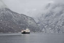 Ferry on the Aurlandsfjord. View from the terrace at Vangsgaarden Guesthouse in Aurland.
