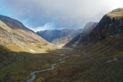 The trail towards Austerdalsbreen Glacier. View from drone towards the viewpoint. The glacier is hiding behind the mountainside.