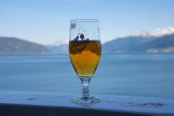 A cold beer and view from the balcony at Hotel Kviknes towards the Sognefjord