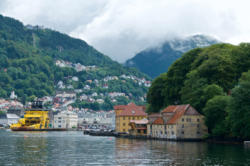 Bergen, the Gateway to the Fjords. Bryggen, Fjellsiden, Fløien and Mt. Ulriken.