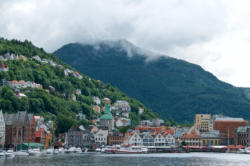 Bergen, the Gateway to the Fjords. Bryggen, Fjellsiden, Fløien and Mt. Ulriken.