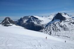 Summer Skiing at Trollstigen, to Mt. Alnestinden. View down towards Trollstigen. Romsdal, Norway.