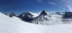 Summer Skiing at Trollstigen, to Mt. Alnestinden. View down towards Trollstigen. Romsdal, Norway.