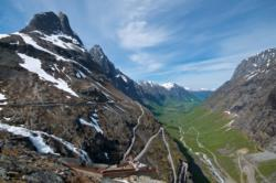 View towards the Trollstigen Mountain Road and the viewpoint. Åndalsnes and the Romsdalsfjord in the background.
