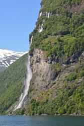 Seven Sisters Waterfall and Knivsflå Mountain Farm by the Geirangerfjord.