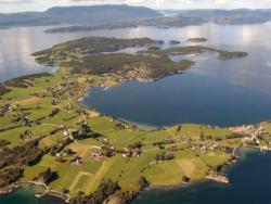 18 The islands of Halsnøy and Huglo with the Hardangerfjord between.