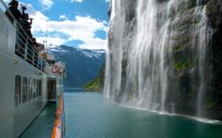 Fjord Cruise on the Geirangerfjord. The Bridal Veil Waterfall cascading into the fjord.