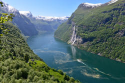 The Geirangerfjord and Skageflå Mountainfarm. The Seven Sisters Waterfall on the other side of the fjord.