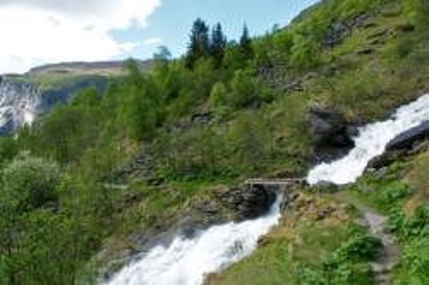 Crossing this waterfall before arriving Sinjarheim Mountainfarm. Photo: www.fjords.com