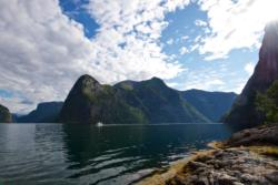 Kayaking on the Aurlandsfjord towards the outlet of the Nærøyfjord. The Aurlandsfjord continues to the left.