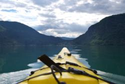 Kayaking towards Solvorn by the Lustrafjord.