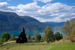 View from Urnes towards Urnes Stave Church. Solvorn on the other side of the Lustrafjord.