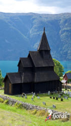 046 iphoneUrnes Stavechurch by the Lustrafjord in Luster. Sogn og Fjordane, Norway.