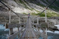 Hiking down from Nigardsbreen Glacier in Jostedalen. Crossing the Glacial River.
