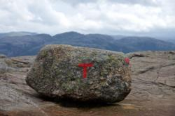 "The path towards Preikestolen is well marked wit the red ""T""."