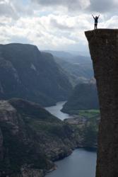 On the edge of Preikestolen. The Lysefjord is 604 metres below the edge.