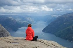Enjoying the view from Preikestolen towards the Lysefjord.