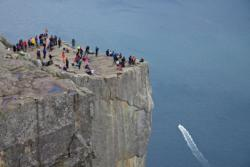 Preikestolen (The Pulpit Rock) is a 25 times 25 metres mountain plateau raging 604 metres above the Lysefjord.