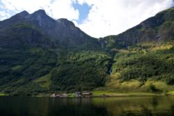Rimstigen seen from the Nærøyfjord, to the left in the picture, on the left side of the river/waterfall. Mt. Bakkanosi to the left.