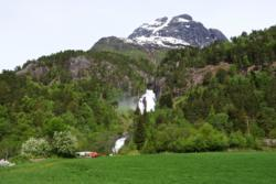 View towards the trail to Segestad. Glomnesfossen Waterfall in the background.