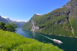 View from Skageflå Mountainfarm. The Geirangerfjord and the Seven Sisters Waterfall in the background. Photo: www.fjords.com