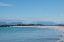 Beach on Ona Island. The Atlantic Coastline in the background. Photo: www.fjords.com