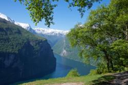 View from Ørnesvingen Viewpoint towards the Geirangerfjord and the Seven Sisters Waterfall.