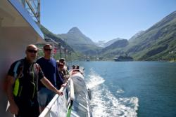 Fjord Cruise on the Geirangerfjord. Geiranger in the background.