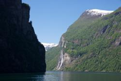 Fjord Cruise on the Geirangerfjord. The Seven Sisters Waterfall in the background.