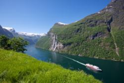 View from Skageflå Mountain farm towards the Geirangerfjord and The Seven Sisters Waterfall.
