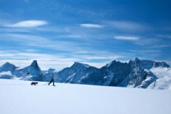 Skiing to Mt. Blånebba in Isfjorden. Mt. Romsdalshorn and Trollveggen in the background.