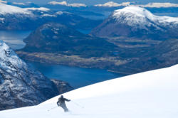 Skiing to Mt. Blånebba in Isfjorden. The Romsdalsfjord in the background.